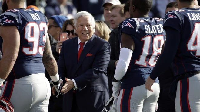 In this Dec. 29, 2019 file photo, New England Patriots owner Robert Kraft greets players on the sideline after they warmed up before an NFL football game against the Miami Dolphins in Foxborough. On Friday, June 5, 2020, the Patriots announced Kraft's family is pledging $1 million to local grassroots organizations to promote social justice. The team says the money will be distributed over the next 10 months in $100,000 monthly donations to recipients chosen in collaboration with Patriots players.