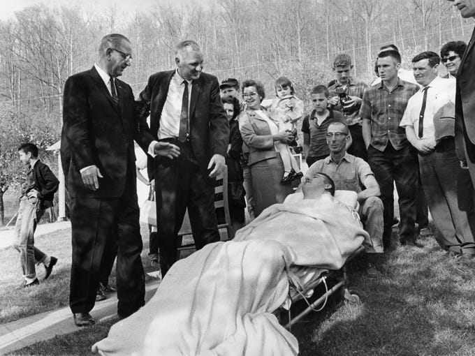 This man refused to let an illness stand in the way of meeting President Lyndon Johnson on his visit to Inez, Ky.  Johnson was on a campaign stop in the state and kicked off his war on poverty program.  April 25, 1964