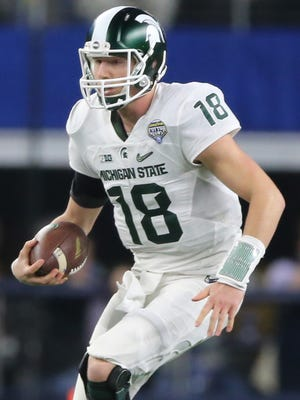 Michigan State Spartans Connor Cook runs against the University of Alabama Crimson Tide during first half action of the Good Year Cotton Bowl game Thursday, December 31,2015 at AT&T Stadium in Arlington Texas.