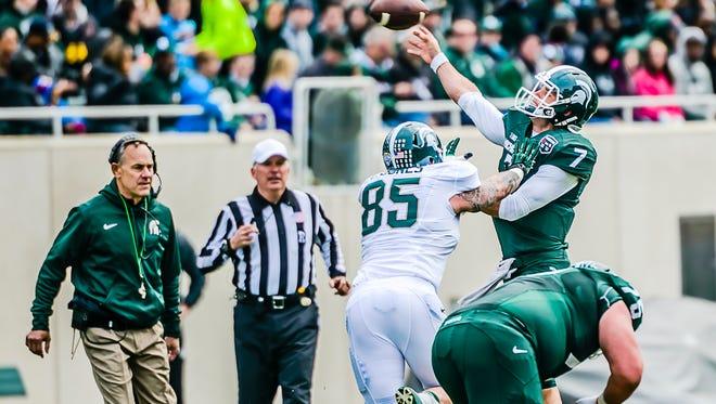 MSU coach Mark Dantonio watches as Evan Jones (85) applies pressure on quarterback Tyler O'Connor during the Spartans' annual spring football game Saturday at Spartan Stadium in East Lansing.