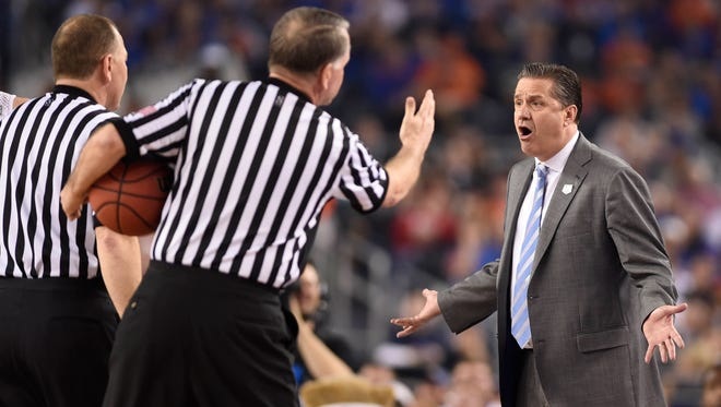 Kentucky Wildcats head coach John Calipari reacts to officials on the sideline against the Wisconsin Badgers in the first half during the semifinals of the Final Four.