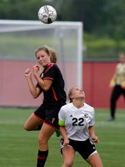 Seymour's Justine Meltz (1) headers the ball by Belleville/New