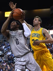 Vermont's Ethan O'Day defends against Nevada's Cameron