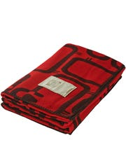 The cozy Flock of Sheep blanket by Woolrich bears the company's iconic sheep logo. (Woolrich)