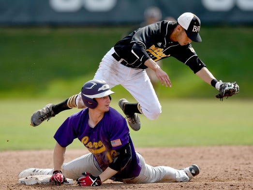 Madison Heights Bishop Foley shortstop flies over Caro