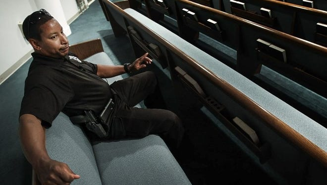 Elbert Jones, a member of the emergency response team at Brown Missionary Baptist Church in Southaven, scans the crowd before a Wednesday night service.