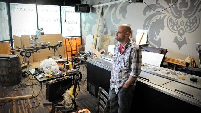 Mike Soule talks Thursday about renovations underway to open his new bar, Whiskey Business, in downtown St. Cloud. Soule plans to open the bar, at 701 St. Germain St., on Aug. 1.