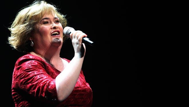 """Susan Boyle performs during her musical """"I Dreamed A Dream"""" at the Theatre Royal in Newcastle, England, in 2012."""