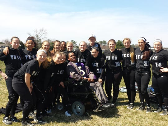 The Sussex Tech softball team and head coach Chester