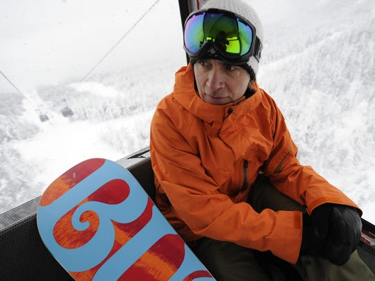 Jake Burton, founder of Burton Snowboards, rides the gondola at Stowe Mountain Resort in 2010.