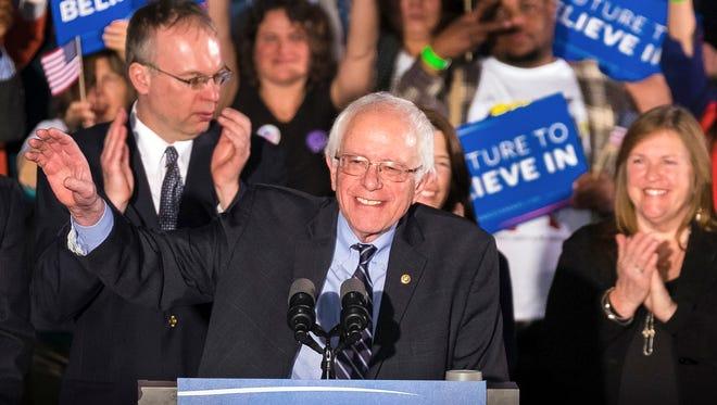 Democratic presidential candidate, Sen. Bernie Sanders, I-Vt, smiles as he speaks at his primary night rally Feb. 9, 2016, in Concord, N.H.