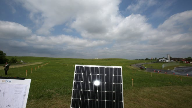 A solar panel is displayed Wednesday at a capped landfill in West Nyack. A ceremony was held there to launch the town's solar field project.