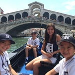 The Gattoni children from Northville show off their Old English D's in Italy. From left: Jack, 10; Nicholas, 12; Taylor, 15, and Grant, 12, cruise down  the Grand Canal by the Rialto Bridge in Venice.