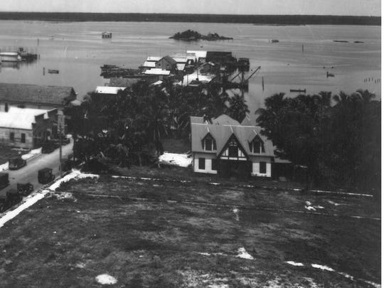This photo, circa 1926, shows the site of future post office with Heitman home/library in background.