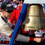Brad Keselowski rings the El Camino Real bell to celebrate winning the NASCAR Sprint Cup Series auto race in Fontana, Calif., Sunday.