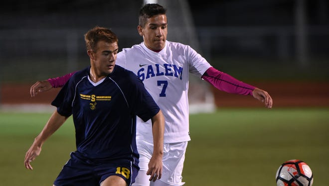 Salem's Shane Rusinek, right, in action against Saline's Ryan Nichols during Tuesday's D1 regional contest.