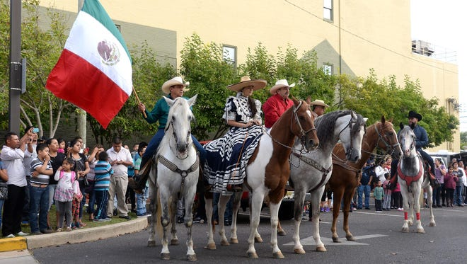 The Mexican flag is carried on horseback during Bridgeton's Mexican Independence Day celebration, Sunday, Sep. 13, 2015.