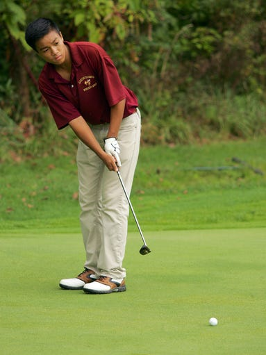Licking Heights' Kenneth Abarra putts on hole four