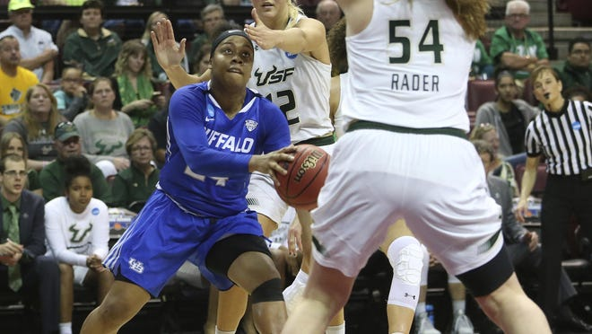 Buffalo's Cierra Dillard drives around South Florida's Maria Jespersen, center, and Alyssa Rader to attempt a shot in a first-round game of the NCAA women's college basketball tournament on Saturday in Tallahassee, Fla.