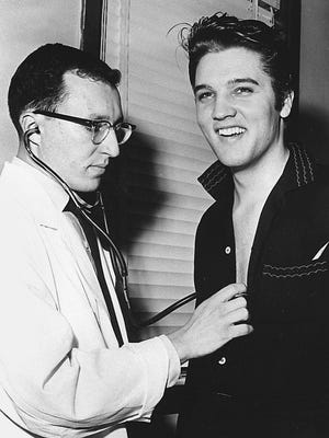 "Elvis Presley reported to Kennedy Veterans Hospital on Getwell the afternoon of Jan. 4, 1957, for his Army pre-induction physical performed by Capt. Leonard Glick and a written qualification exam administered by Lt. Jack Zager just days before his 22nd birthday (Jan. 8). Elvis left for New York by train later that evening for his third and final appearance on Ed Sullivan's ""Toast of the Town Show"" which broadcast January 6."