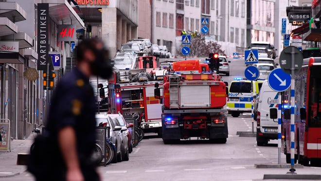 Emergency crews work at the scene where a truck crashed into a department store in central Stockholm on April 7, 2017.