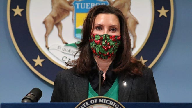 In this photo provided by the Michigan Office of the Governor, Gov. Gretchen Whitmer addresses the state, Friday, Jan. 22, in Lansing. Whitmer announced Michigan restaurants and bars can reopen for indoor dining at 25% capacity but with a 10 p.m. curfew starting Feb. 1, and concessions can resume at casinos, movie theaters and stadiums.