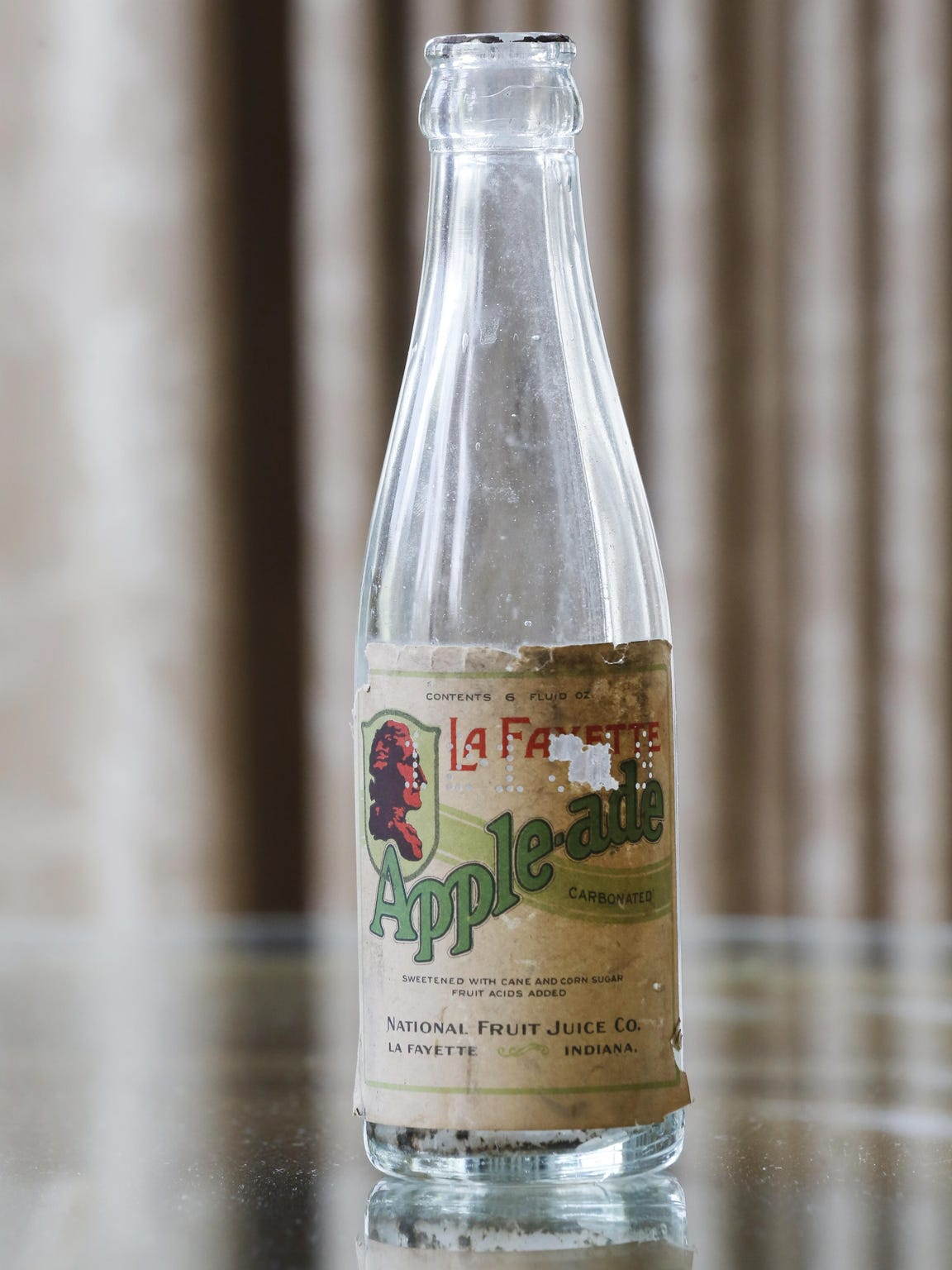 A Thieme & Wagner's Apella Apple-ade bottle that is