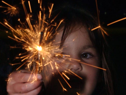 sparkler held by a child during an Independence Day celebration in Scolpino Park in Brewster July 3, 2005.