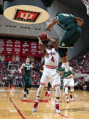 Indiana Hoosiers guard Robert Johnson (4) takes a shot against Michigan State Spartans forward Marvin Clark Jr. (0) at Assembly Hall.
