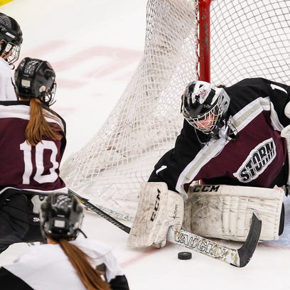 D.C. Everest Co-op goalie Renee Hosler deflects a shot by Hayward Co-op's Nadya VanVonderen during the second period at a WIAA state tournament semifinal game March 6, 2015, in Madison. (Photo © Andy Manis)