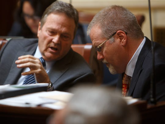 Sen. Jerry Stevenson, left, speaks to former Sen. Steve Urquhart on the floor of the Utah Senate at the Utah State Capitol in this Spectrum file photo.