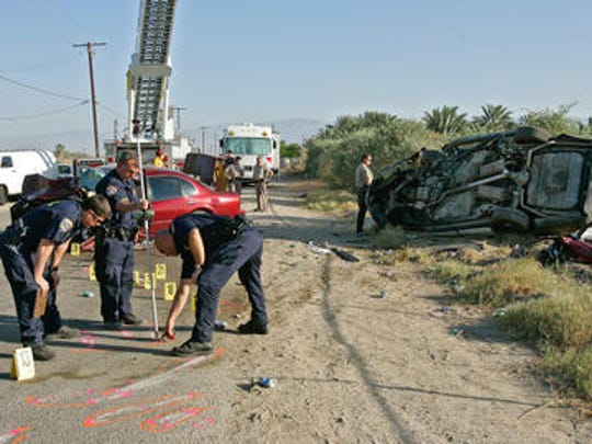 This Desert Sun file photo shows California Highway Patrol officials investigating a fatal 2007 collision that involved Riverside County Sheriff's Deputy Manuel Villegas.