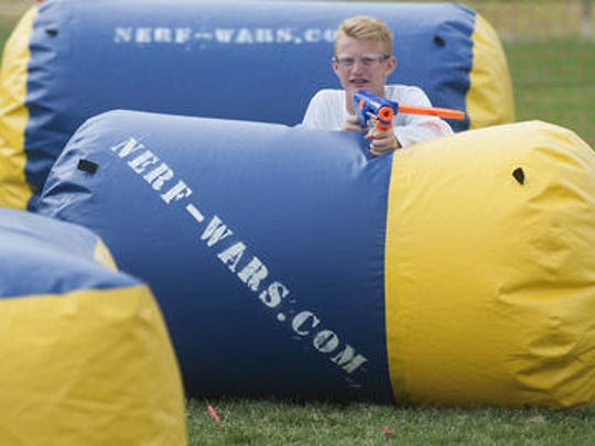 Cinnaminson High School varsity soccer player Jake Weick takes cover during a Nerf Wars event recently. Austin Dasher, a 17-year-old Delanco teen, started the company recently, which puts on Nerf battles all around South Jersey and the state. They do birthday parties, team building events, community events and more.