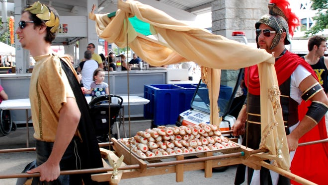 How else would cannoli be delivered at Festa Italiana? A cannoli-eating contest is part of the festivities at Festa, which returns to Maier Festival Park at the lakefront July 21 to 23. It's the festival's 40th anniversary.