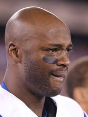 Indianapolis Colts WR Reggie Wayne has a tear in his eye as he listens to the national anthem before the game with the giants