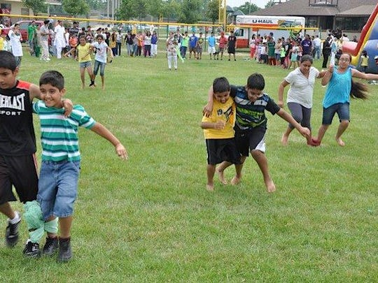 Children participate in one of the athletic events during a previous Punjabi festival in Canton.