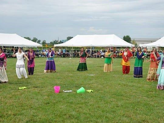 Women perform a Punjabi cultural dance.