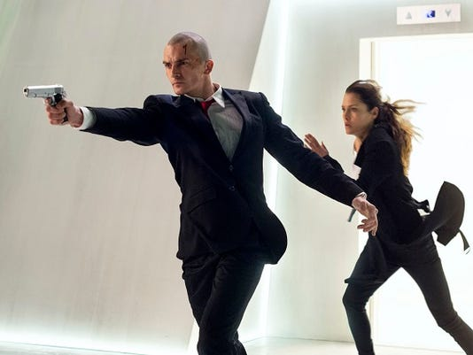 """In this image released by Twentieth Century Fox, Rupert Friend, left, and Hannah Ware appear in a scene from, """"Hitman: Agent 47."""""""