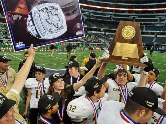 Jason Palmer / Special to the Times Record News The Crowell Wildcats celebrate their 78-52 win over May during the 2013 UIL football Six-Man Division I state championship game at AT&T Stadium in Arlington.