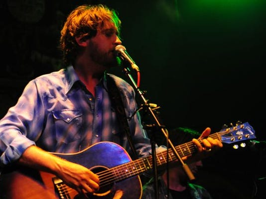 Hayes Carll playing to a crowd Friday night