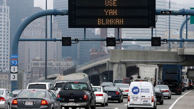 """In this May 9 photo, a sign in Boston shows the term """"Use Yah Blinkah."""" The Mass. Dept. of Transportation posted the message """"Changing Lanes? Use Yah Blinkah"""" on the signs in the city."""