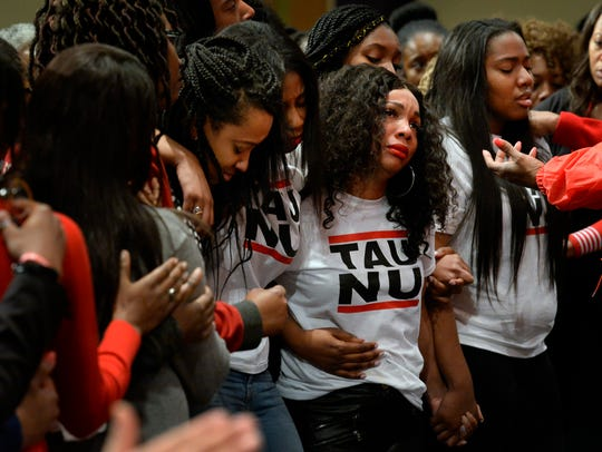 Tau Nu Delta Sigma Theta sorority sisters from Belmont University grieve for fellow sister DeEbony Groves, who was killed at the Waffle House, during a prayer vigil at the Mount Zion Baptist Church Monday, April 23, 2018, in Antioch, Tenn.