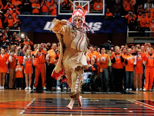 University of Illinois mascot Chief Illiniwek performs for the last time during a 2007 basketball game in Champaign, Ill.