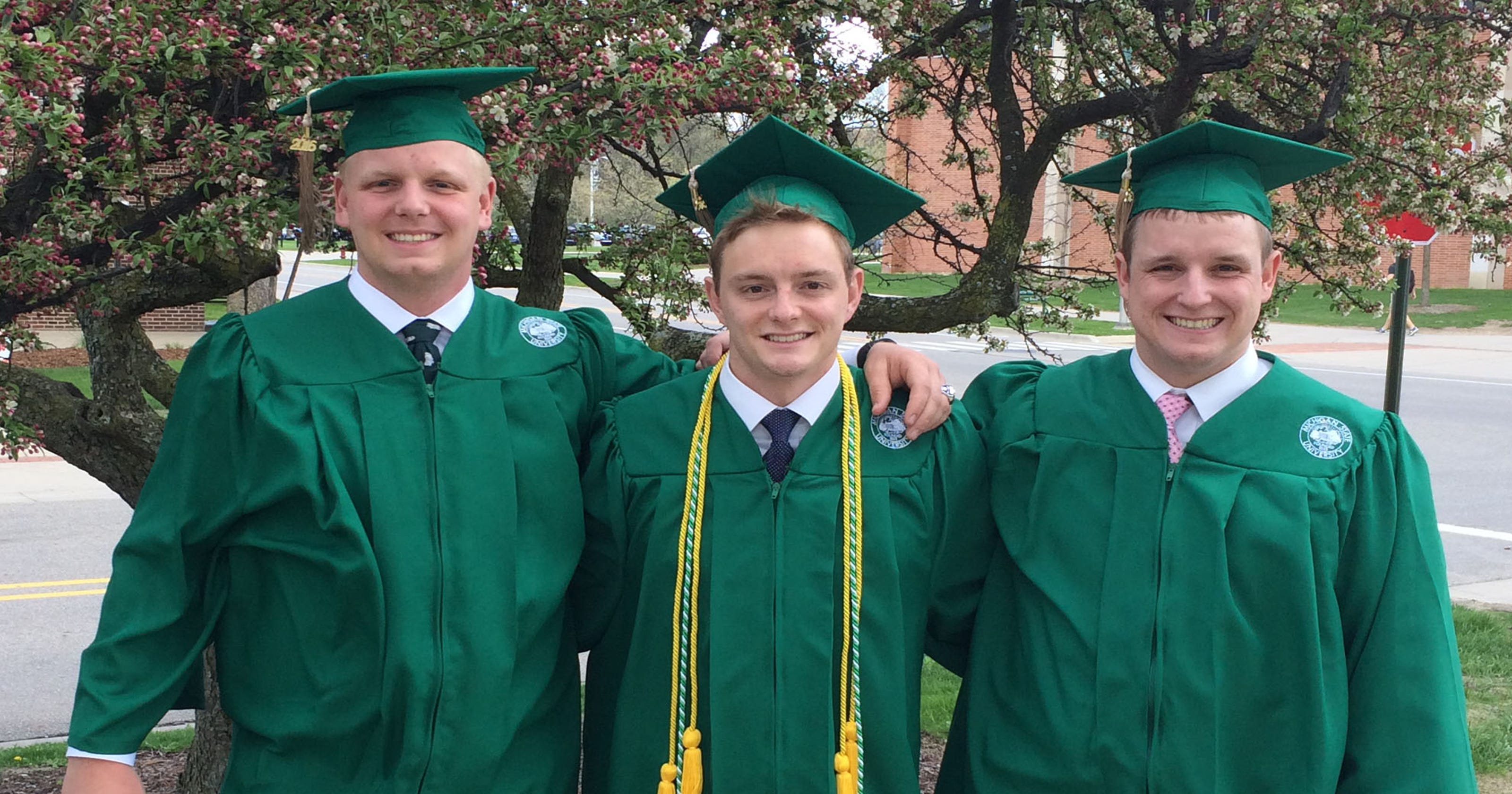 Triplets carry on family tradition with degrees from MSU