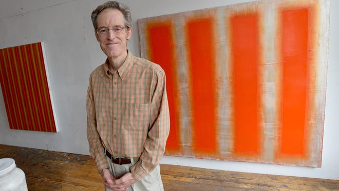 Artist Robert Stuart stands in his studio overlooking West Beverley Street in downtown Staunton on Friday morning, August 8, 2014. Stuart will be exhibiting his work at Staunton-Augusta Art Gallery from Aug. 15 to Sept. 20.