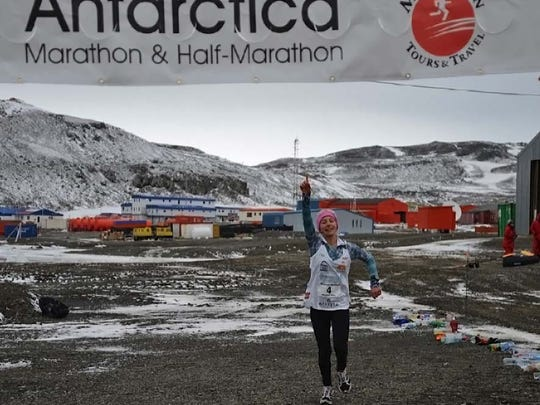 Winter Vinecki takes part in the Antarctica Marathon on Saturday, March 30, 2013. Winter set a world record for the youngest person to run a marathon in Antarctica.