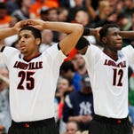 U of L's Wayne Blackshear, #25, left, and Mangok Mathiang, #12, are dejected during the closing minutes of their loss to Michigan State in OT during the Elite 8 tournament game in Syracuse, NY. March 29, 2015
