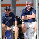 Notre Dame head coach Steve Weber, left, sits with assistant coach Bruce McMail during the Crusaders' 15-4 victory over Sandy Creek in the Class C state quarterfinals on June 5 at Union-Endicott High School.