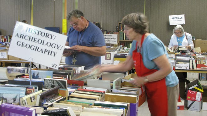Volunteers constantly replenish books on the tables from hundreds of cartons lined up on the floor below. The Friends of the Penfield Public Library (FPPL) work all year to organize this event.