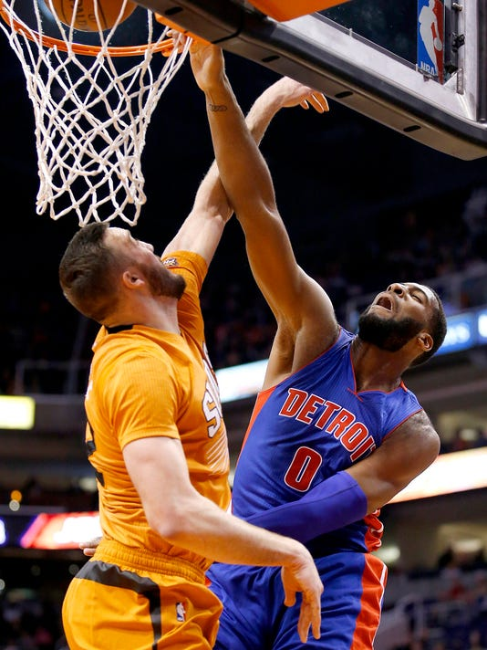 Detroit Pistons' Andre Drummond (0) gets his shot blocked by Phoenix Suns' Miles Plumlee, left, during the first half of an NBA basketball game Friday, Dec. 12, 2014, in Phoenix. (AP Photo/Ross D. Franklin)